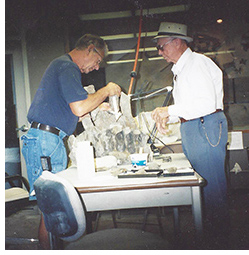 Bill and Jane's Father working on the Hadrosaurid Sacrum