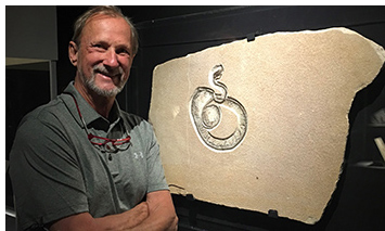 Tom Lindgren with the Green River Snake Fossil